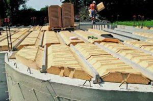 Coffrage en bois pour remplacer ceux en béton lors de la création des planchers pour les maçons